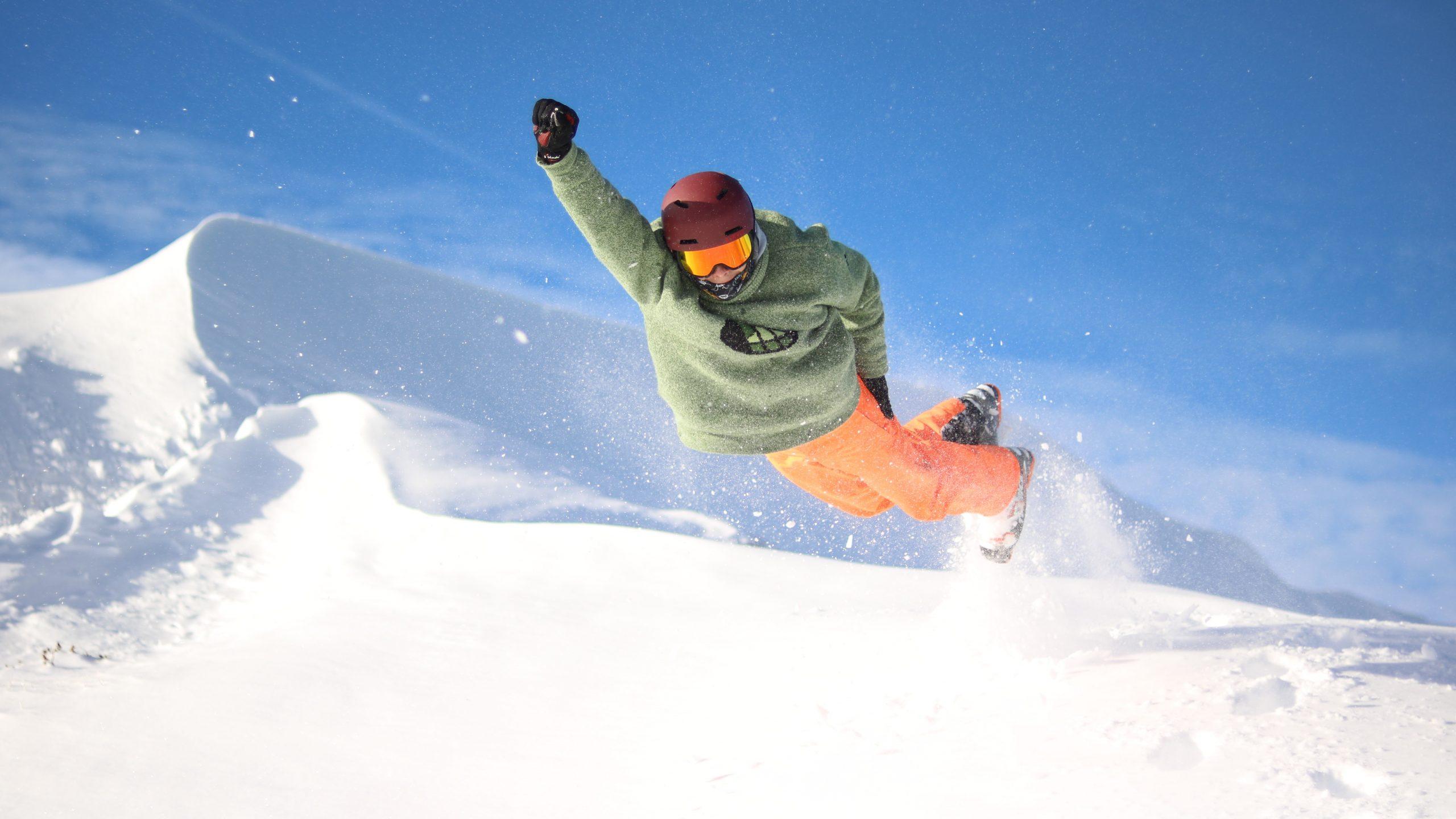 Ski- oder Snowboard fahren
